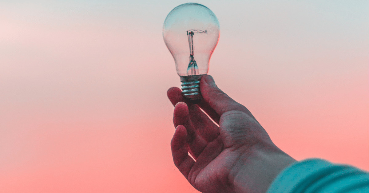 holding out a light bulb for inspiration