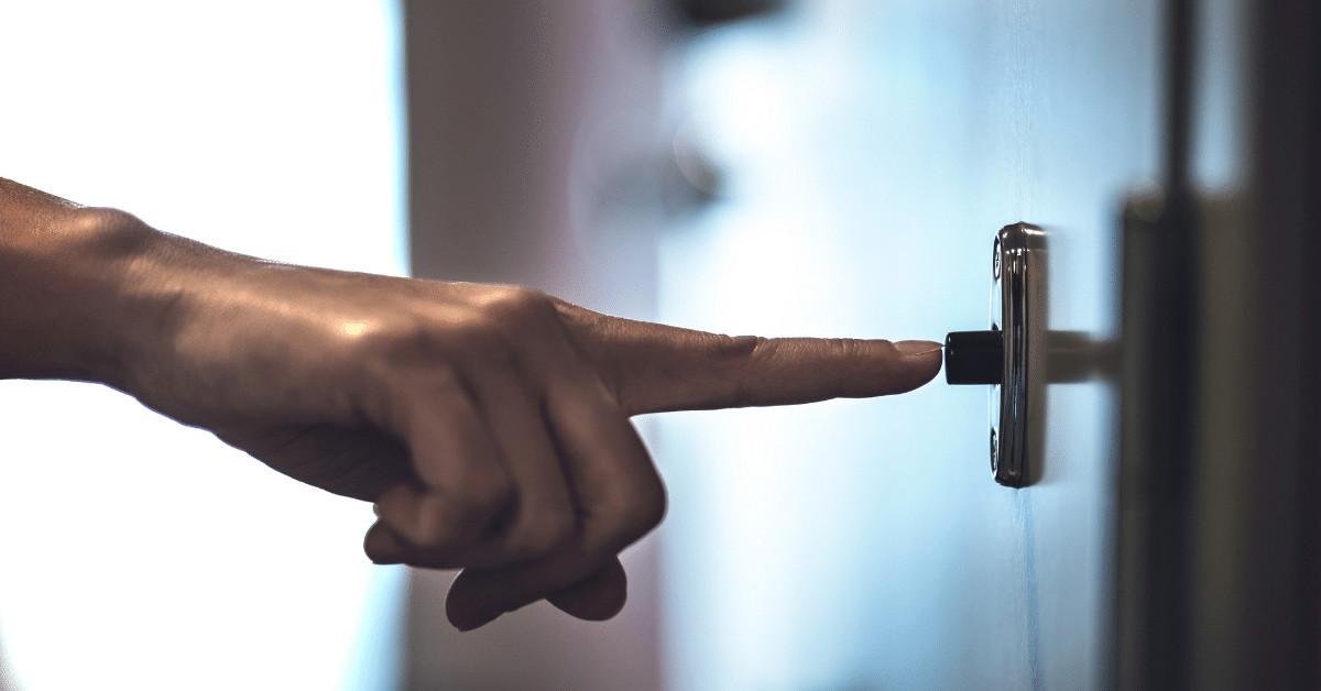 a finger ringing a doorbell