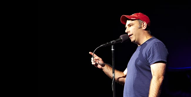 Matthew Dicks standing at a microphone, telling a story